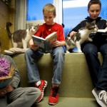 "Kaitlyn Karkoska, Seth Wiggins, and Ethan Wiggins read to ""Stewart"" and ""Tyler,"" at the Berks County Animal Rescue League in Birdsboro"