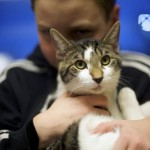 "Ethan Wiggins cuddles ""Tyler,"" at the Berks County Animal Rescue League in Birdsboro"