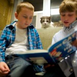"Samuel Trego and Ben Spiri read to ""Stewart,"" at the Berks County Animal Rescue League in Birdsboro"
