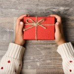 little-girl-hands-holding-gift-box_23-2147576810